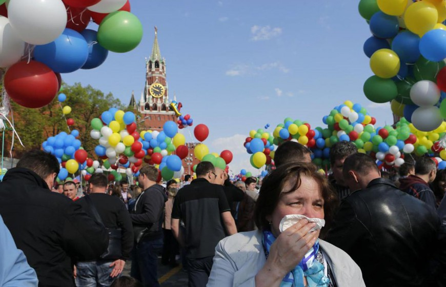 People walk with balloons towards Red Square during a rally in Moscow on 1 May 2014. Russians celebrate the coming of Spring and since communist times, Labour Day on the first day of May.