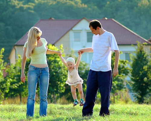 Happy family on meadow